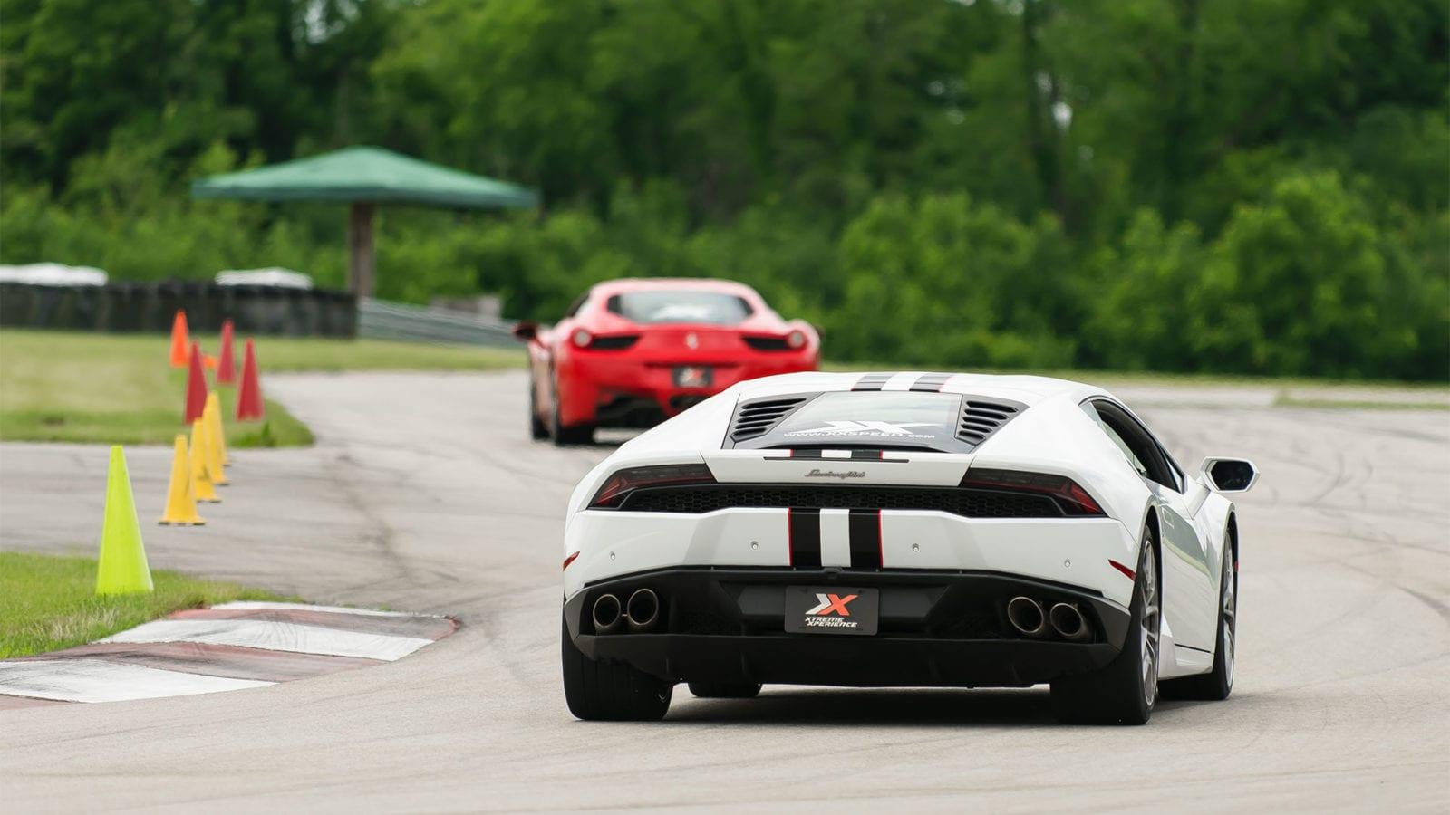 Lamborghini Huracan and a Ferrari 458 Italia on a racetrack
