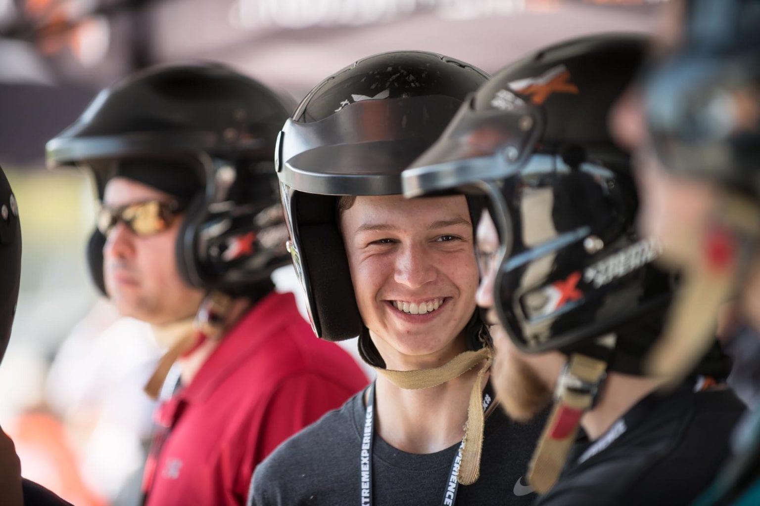 Smiling man in racing helmet