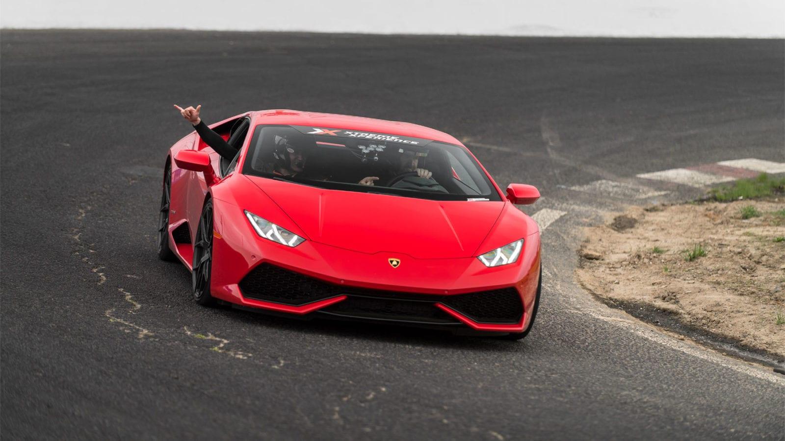 Lamborghini Huracan in red on racetrack