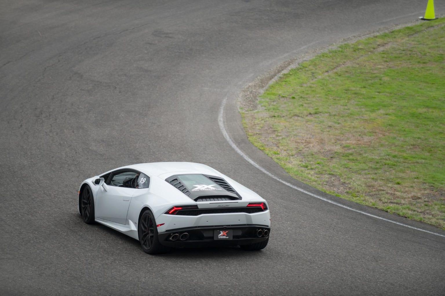 white car on track
