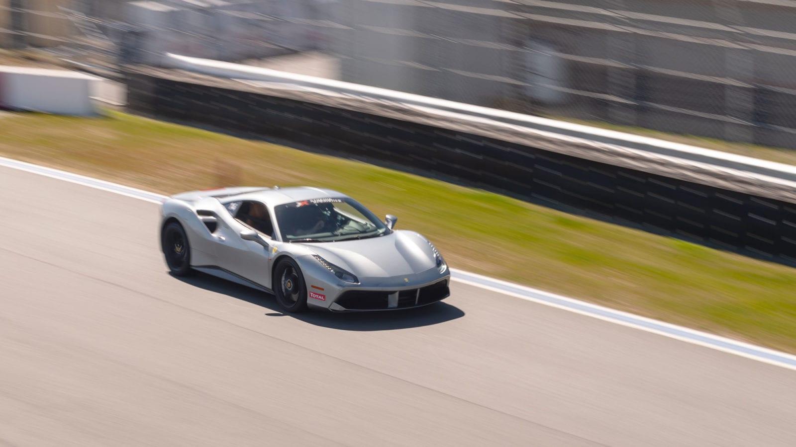 Ferrari 488 GTB in silver on the racetrack