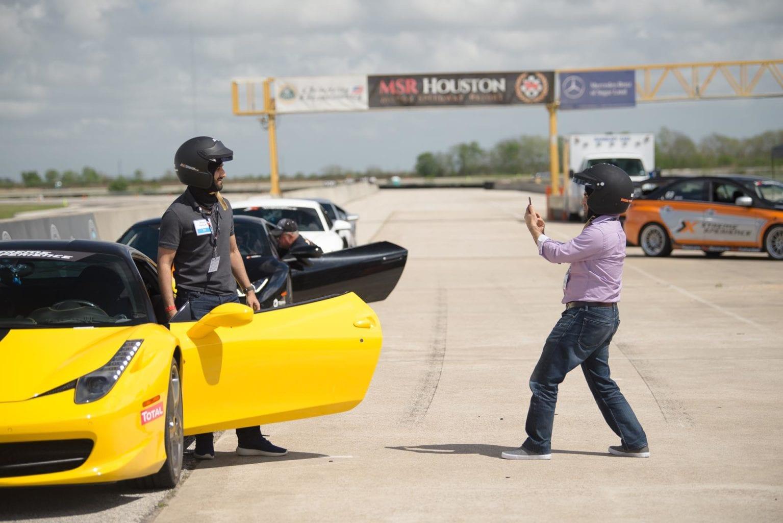 photo being taken of racecar driver
